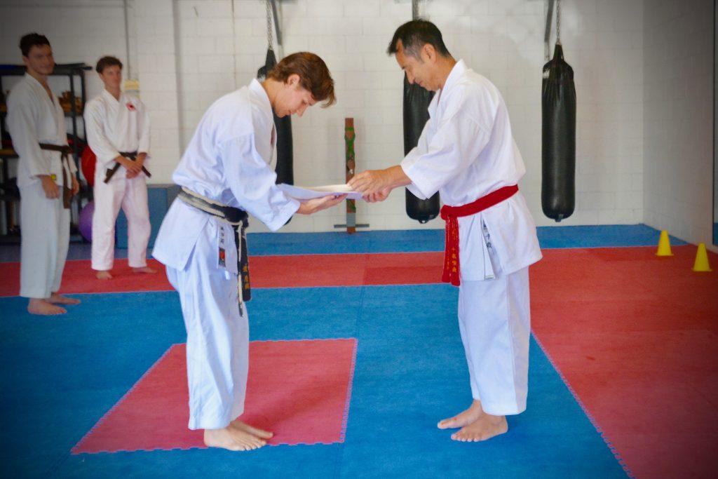 Sensei Sandra receiving 5th Dan & Shihan (master instructor) certificates, 2016.